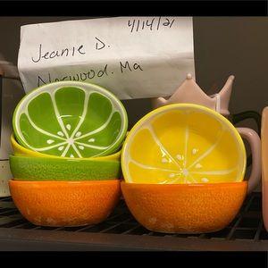 Orange,lime,lemon bowls